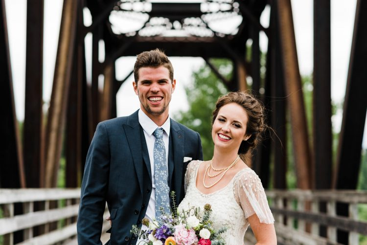 bride and groom standing on bridge in tatamagouche, nova scotia