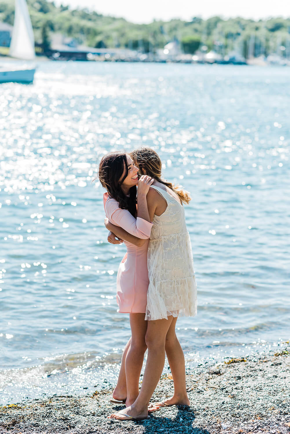 Two women hugging at the park beach
