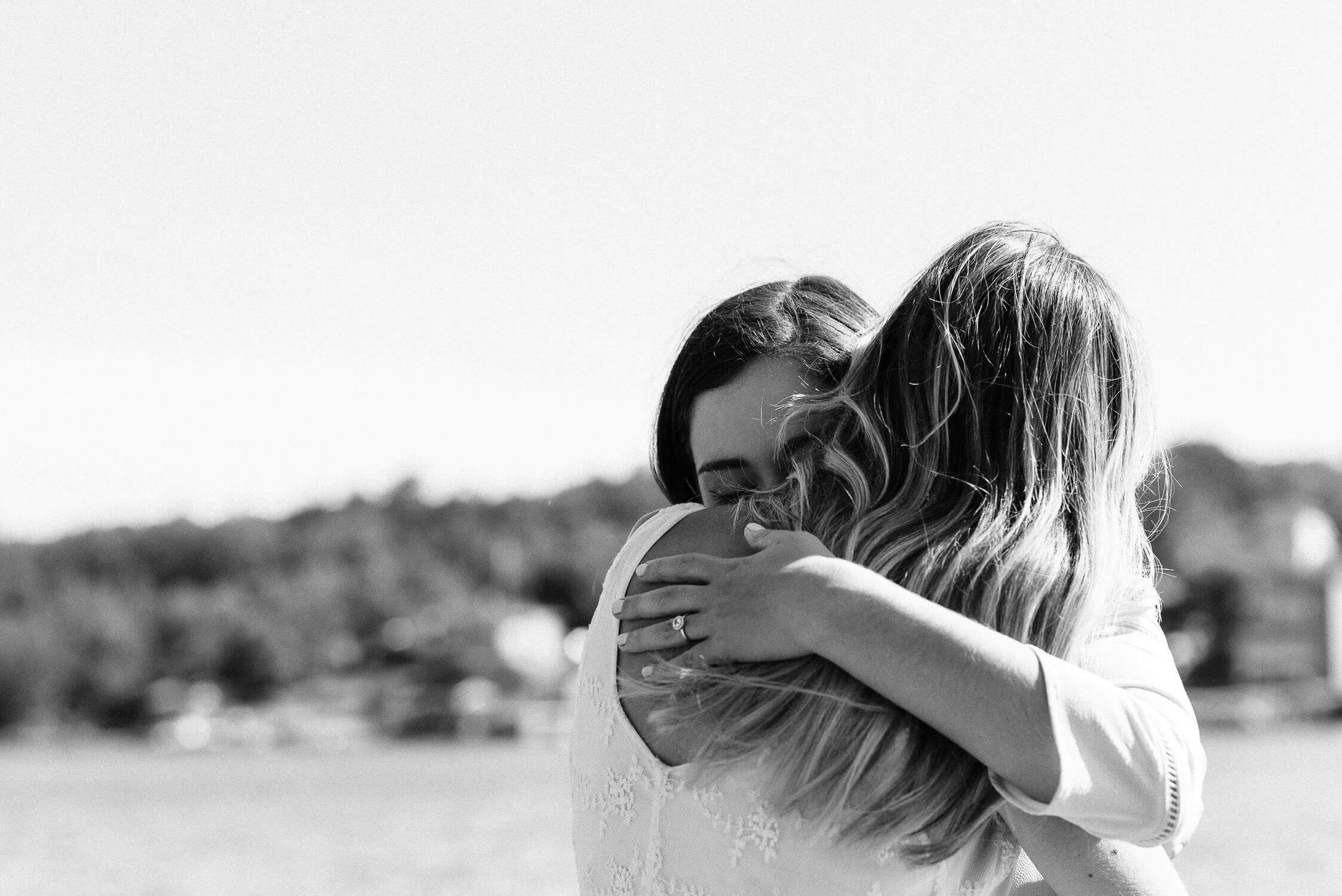 Woman hugging her partner in the park
