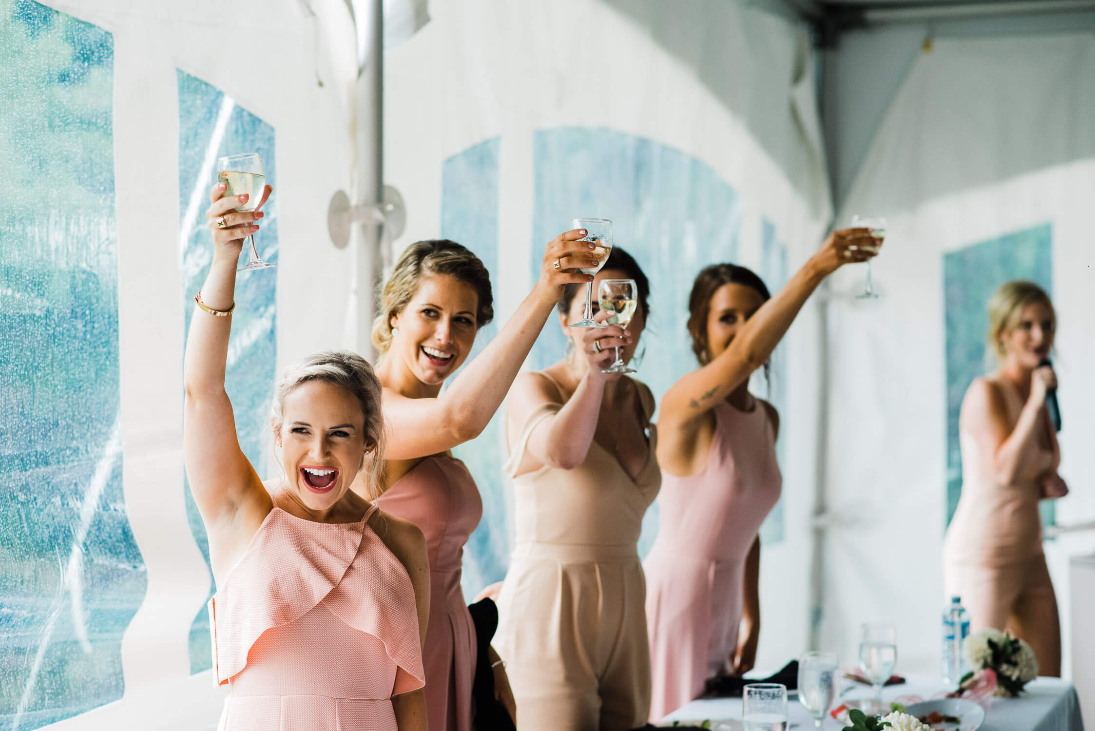 Bridesmaids cheers at a wedding reception in Jeddore