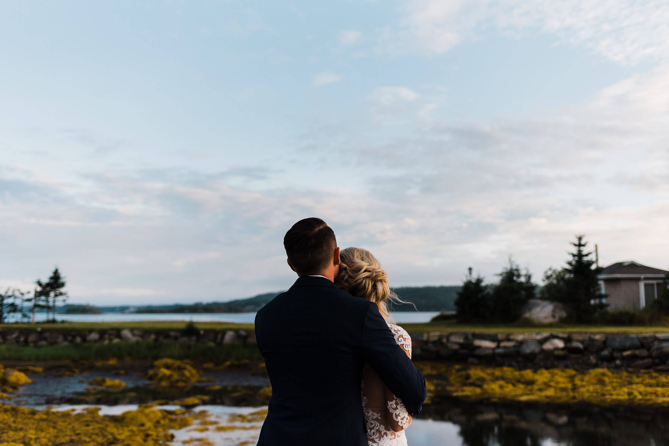 bride and groom enjoying a nova scotian sunset
