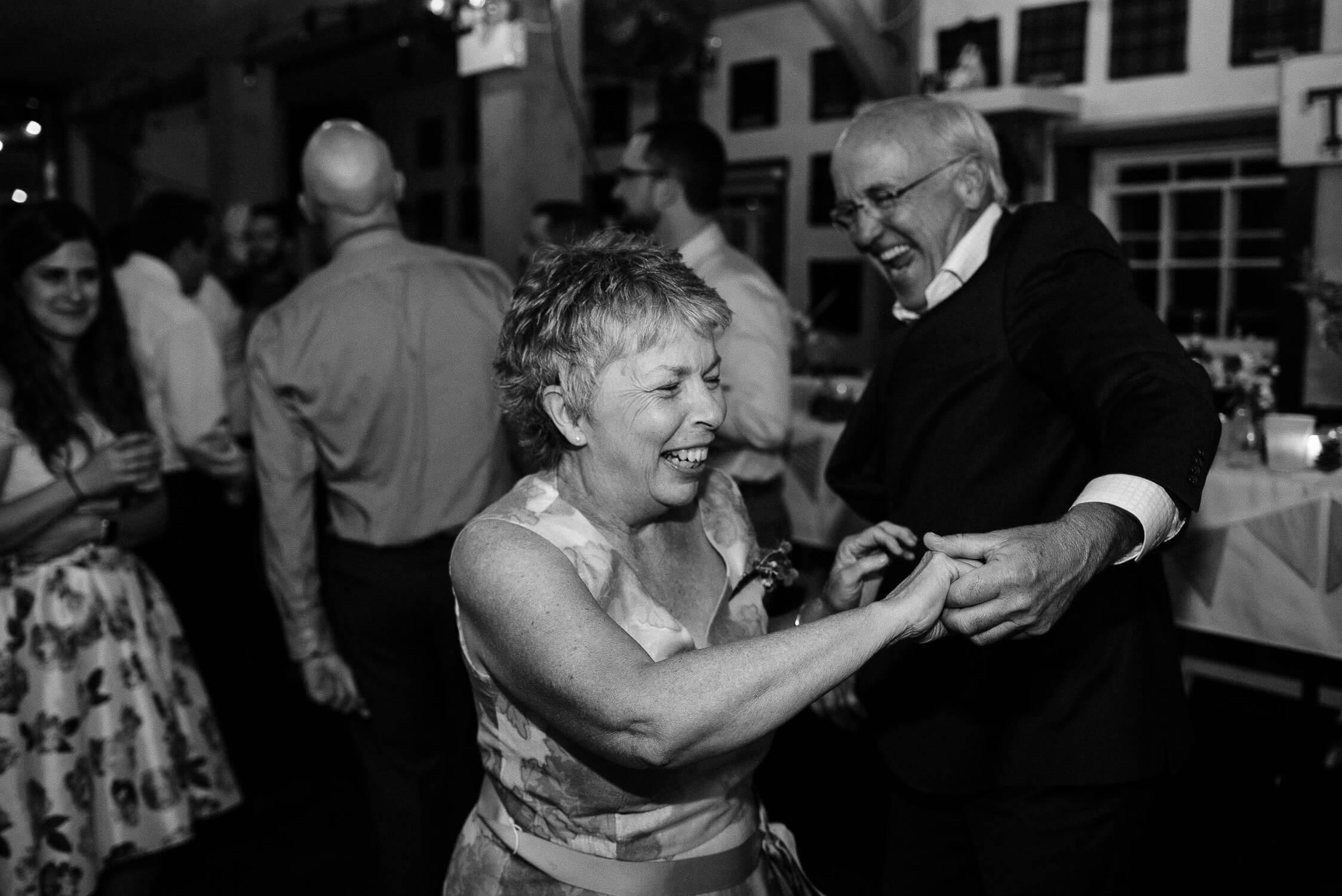 wedding guests having fun dancing at a reception