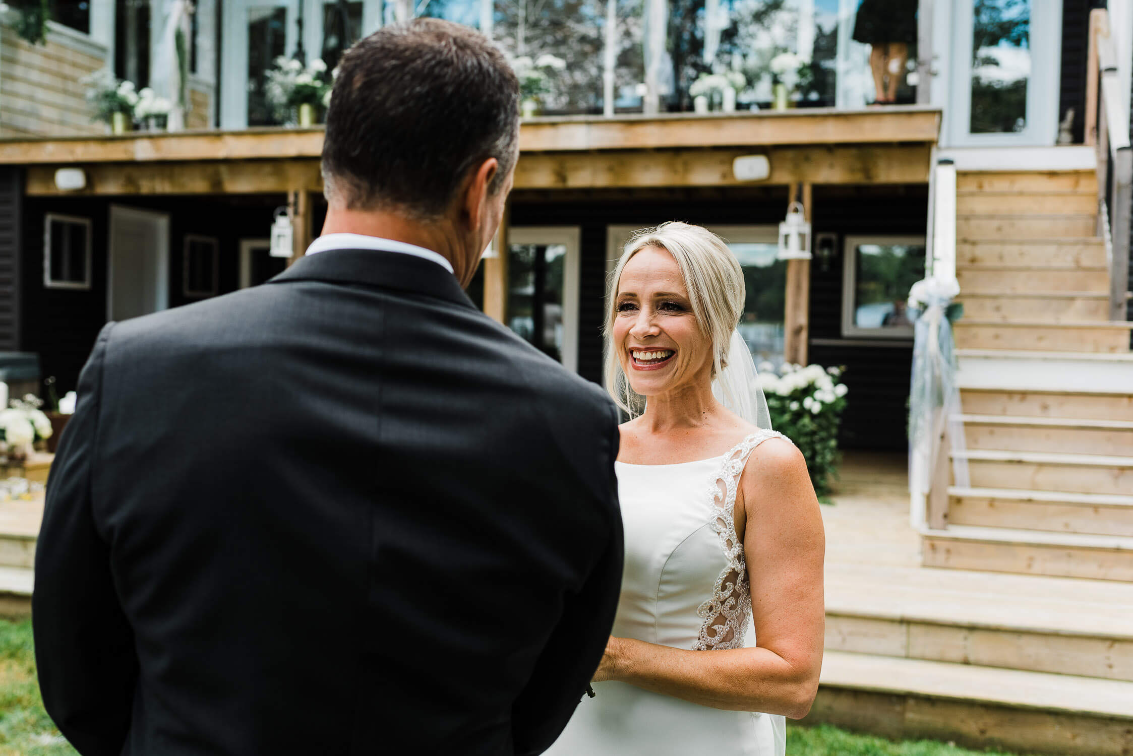 Bride smiles as she sees her groom during the first look
